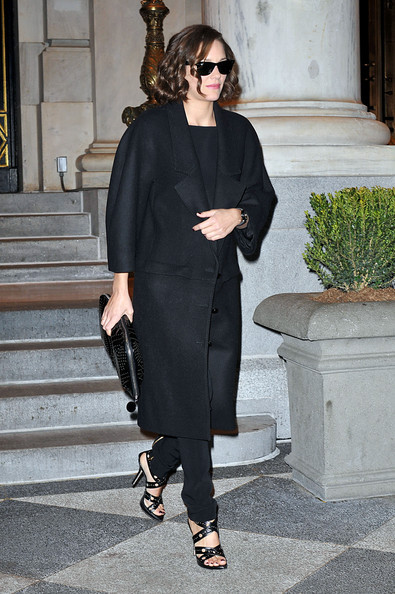 Marion Cotillard in a black Dior Coat