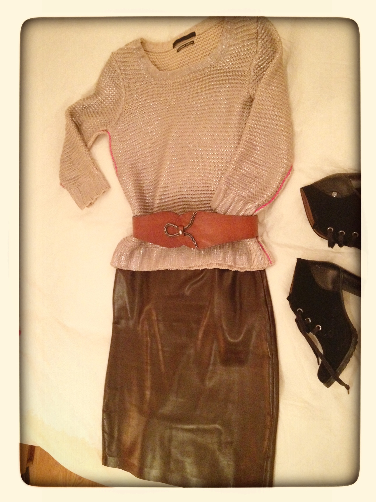 Metallic jumper and leather skirt