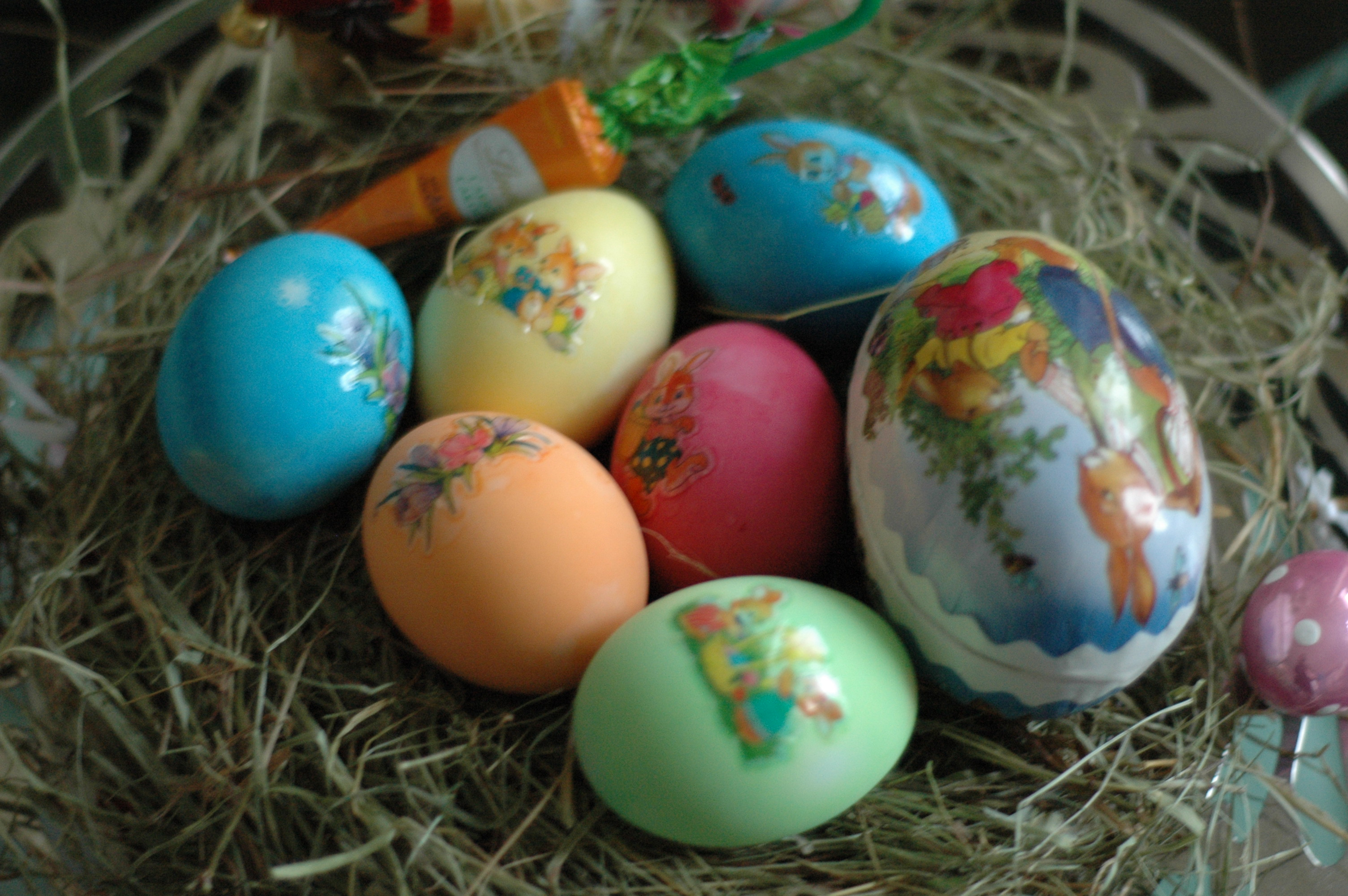 Decorated easter eggs in a hay nest
