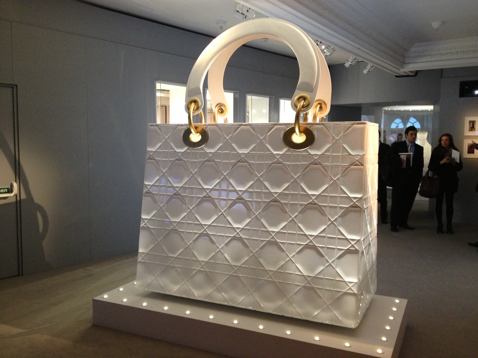 The quilted, giant lady Dior handbag is used as a screen to project images and videos of how the bag is crafted.