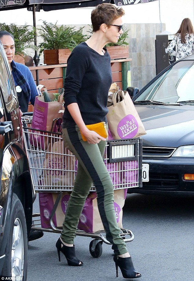 Charlize in skinny jeans and stilettos