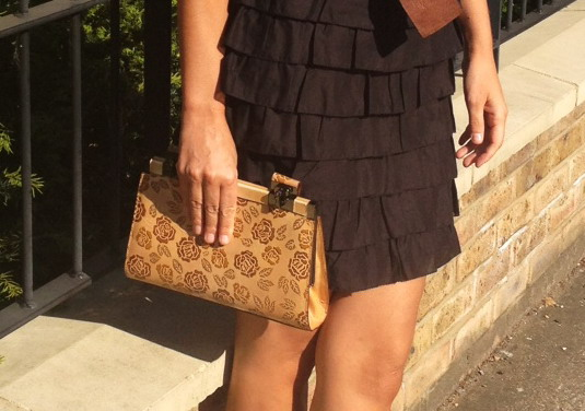 My embellished, flowery tan clutch with small handles from Dolce & Gabbana