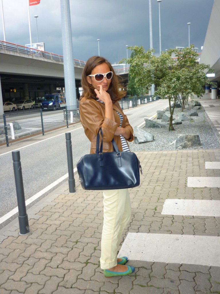 I'm wearing a structured, square and hand held bag by Calvin Klein, the ultimate bag shape according to Giorgio Armani!