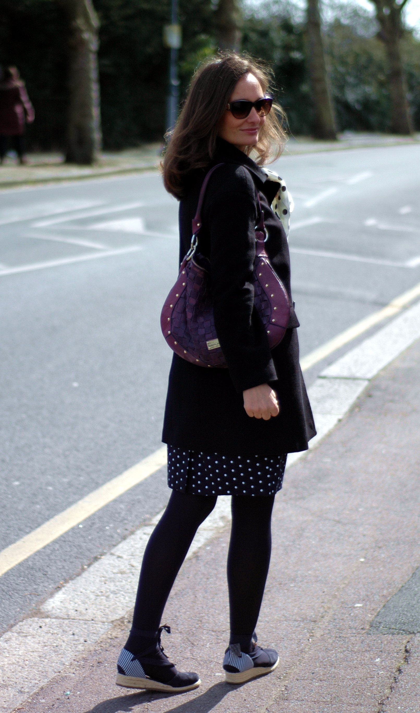 Polka dot dress and black coat