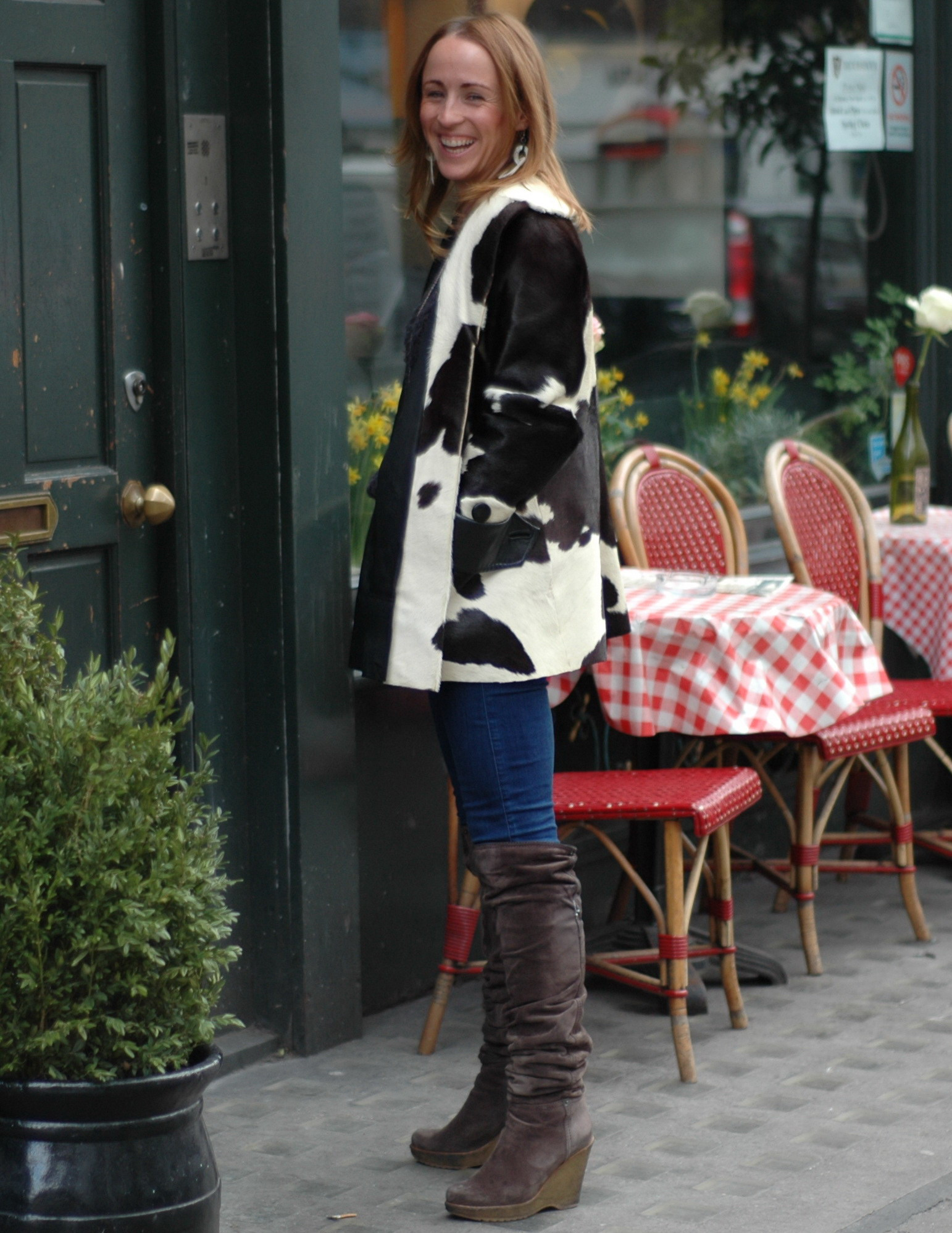 Nikki in her cool cow skin coat