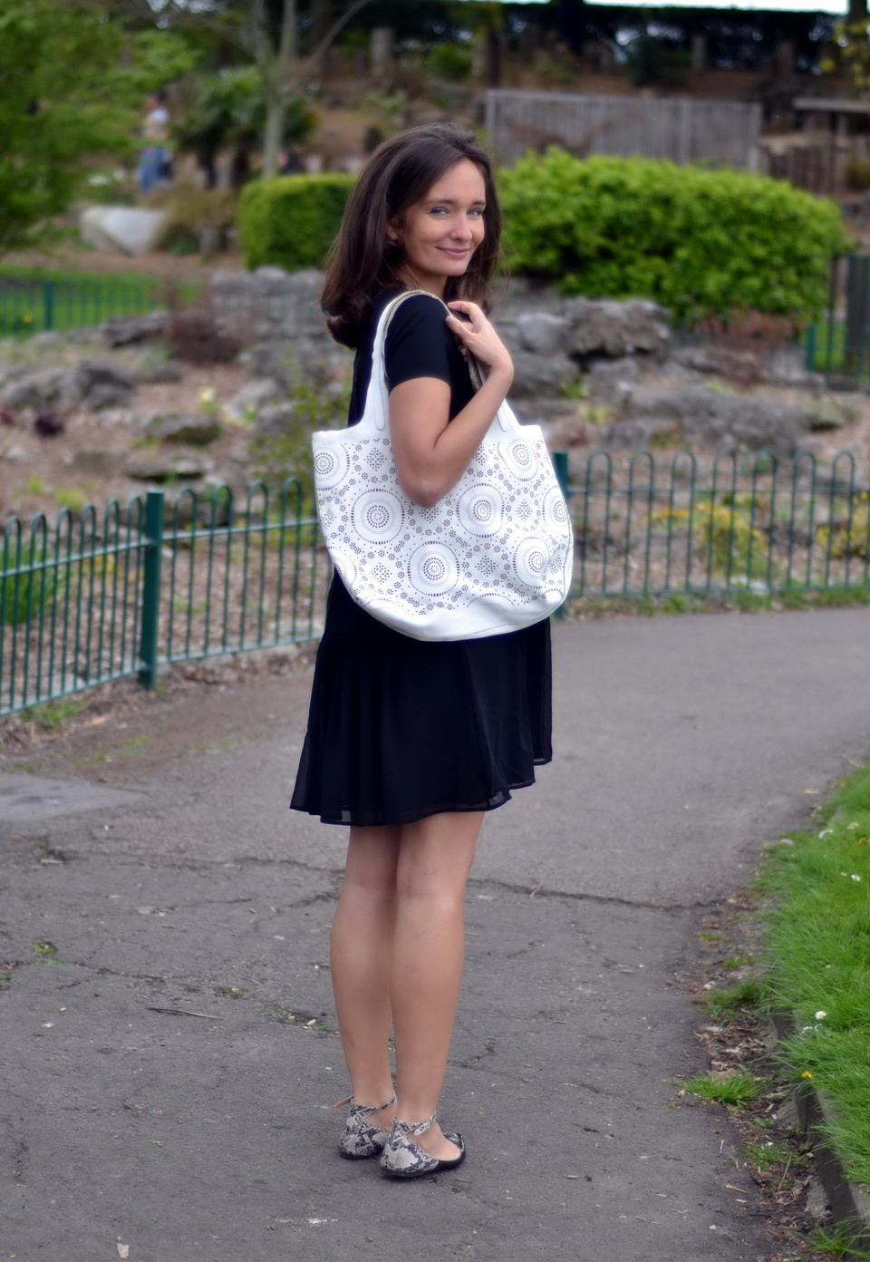 White lasercut bag from Alchimia. The perforated leather looks like lace, love the effect!