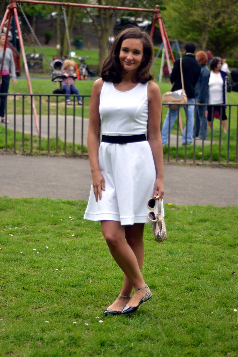 White sunglasses from Moschino, black patent flats from BCBG, dress and belt from Max & Co