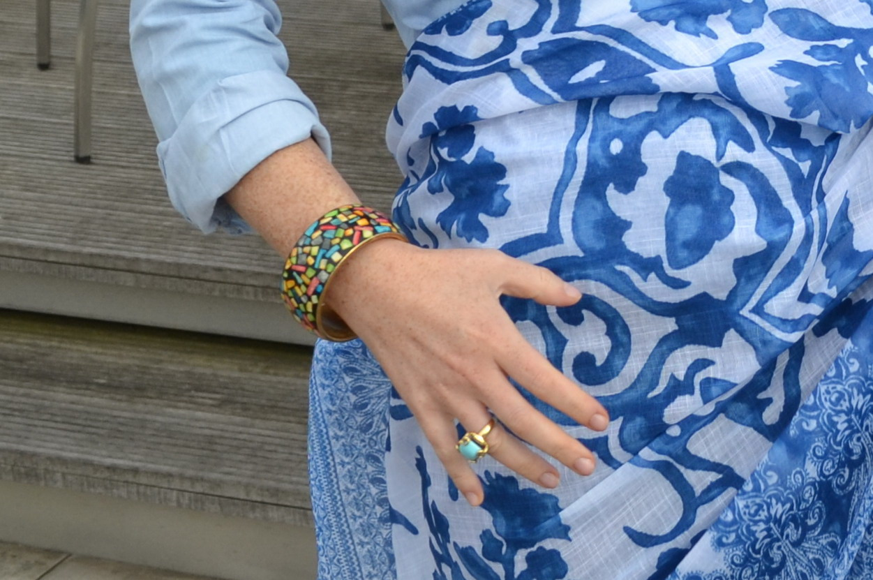 Bérengère likes to accessorise: Bracelet from the markets in Camden, turqoise ring from Gucci, blue scarf from Zara.