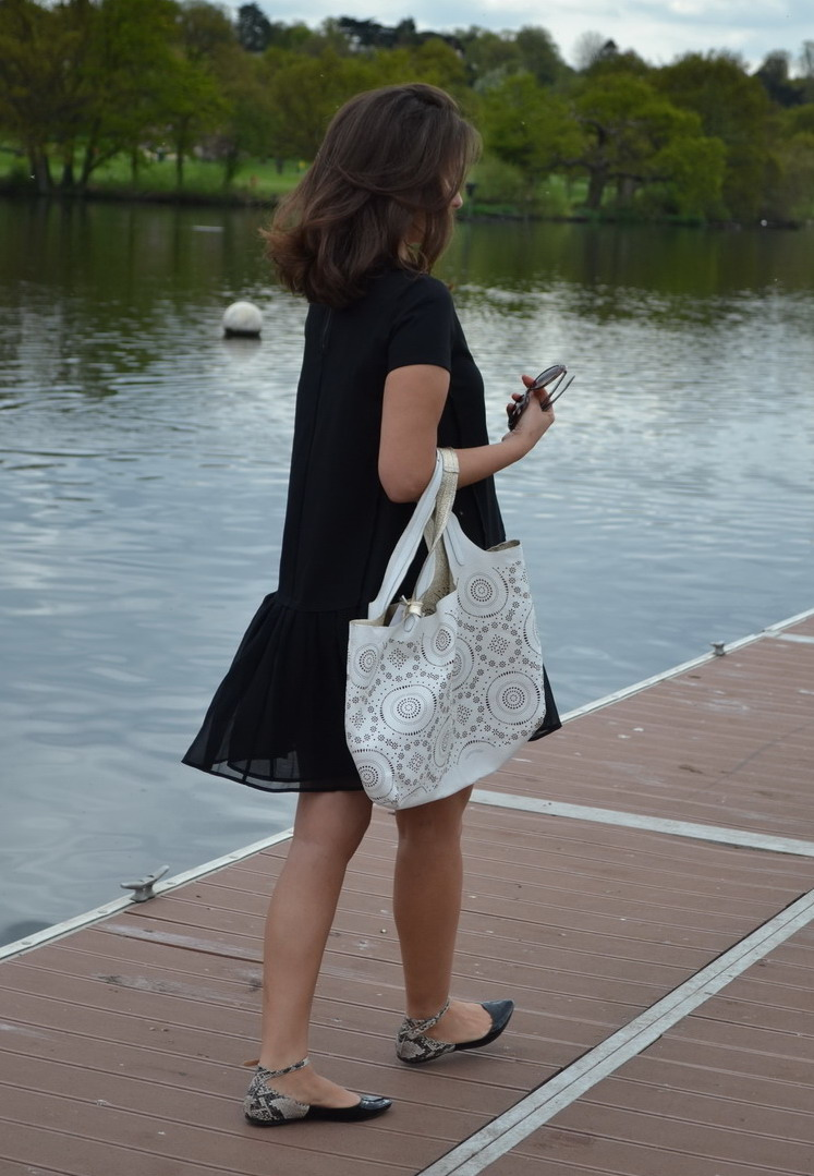 Dress from Max & Co. Lace, lasercut  bag from Alchimia