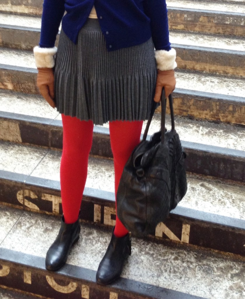 I am wearing red coloured pop tights from Falke with a pleated wool skirt from Stefanel