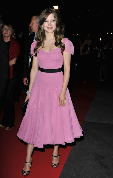 Turning up the girly charm in a flared  pink Louis Vuitton dress with puff sleeves and black contrast belt - parfait!