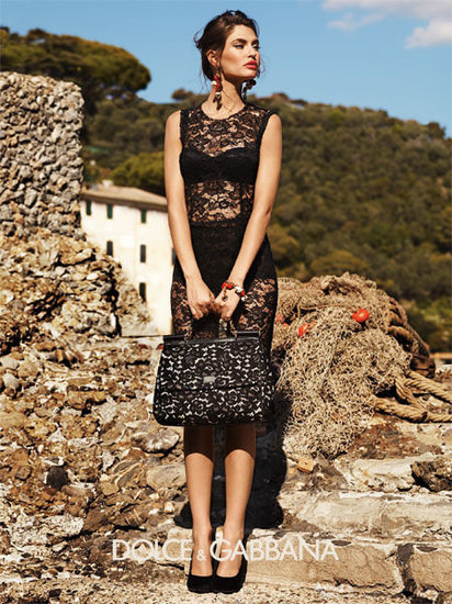 Ingredients for Dolce and Gabbana's ad campaigns? Take a gorgeous model, throw in rustic Italian seaside setting, garnished with a little black lace dress and matching lace tote bag.