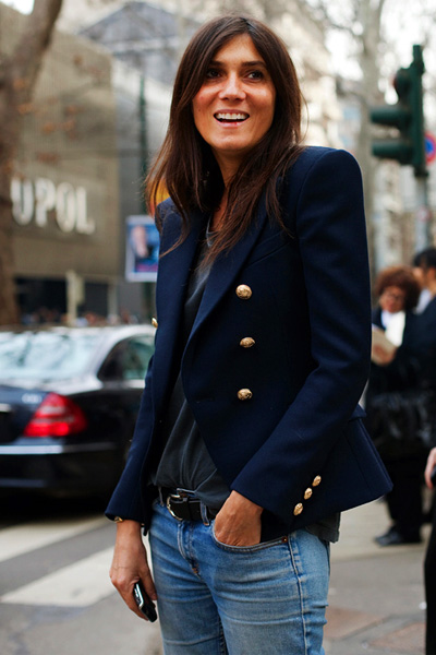 Emmanuelle Alt wearing a navy blue Blazer with gold buttons from Balmain.