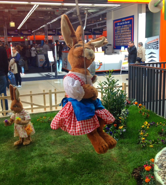 This fashionable easter bunny on a chair swing ride  is wearing a bang-on-trend vichy/gingham dress. Adorbs!