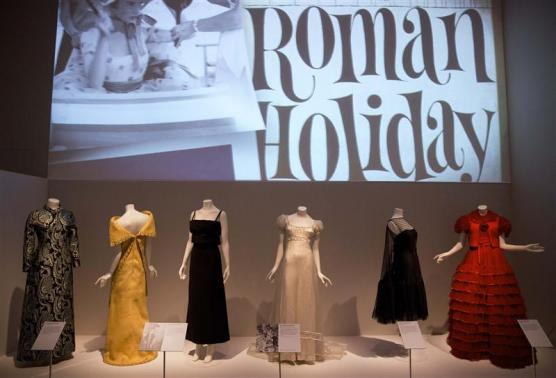 "Dresses worn in films are seen displayed during a media preview of the ""The Glamour of Italian Fashion 1945-2014"" exhibition, at the Victoria and Albert Museum in London"