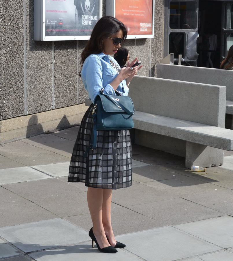 Street style at the Vogue Festival: Loving the geometric midi tartan skirt and teal coloured Mulberry bag candy