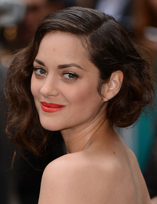 French actress Marion Cotillard is another fan of Russian Red.  In this picture, she is wearing an organey-red. Try the new NARS Audacious lipstick in Annabella.