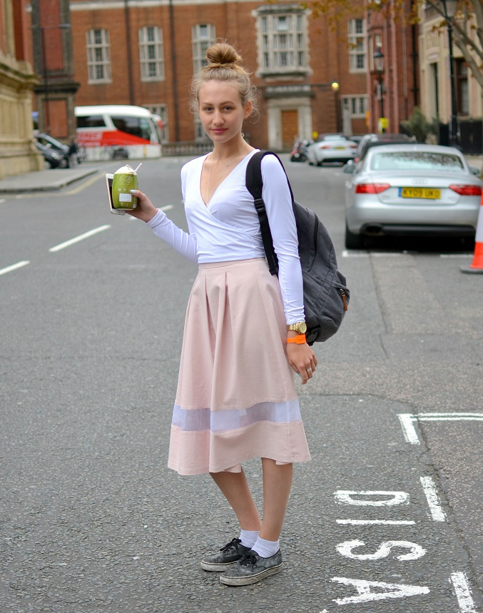 Beating the weather blues with a coconut drink. I love the peek-a-boo midi skirt and the dirty sneakers. Such a London look!
