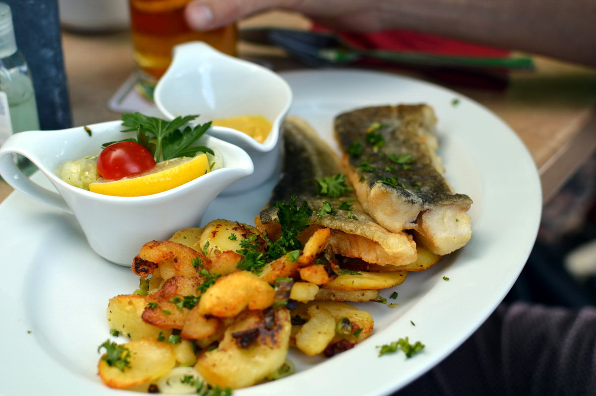 Perch fish from the baltic sea and typical german fried potatoes.