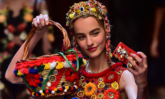 Wicker basket and dress with pom poms and mirrors. Photograph: Giuseppe Cacace/AFP/Getty Images