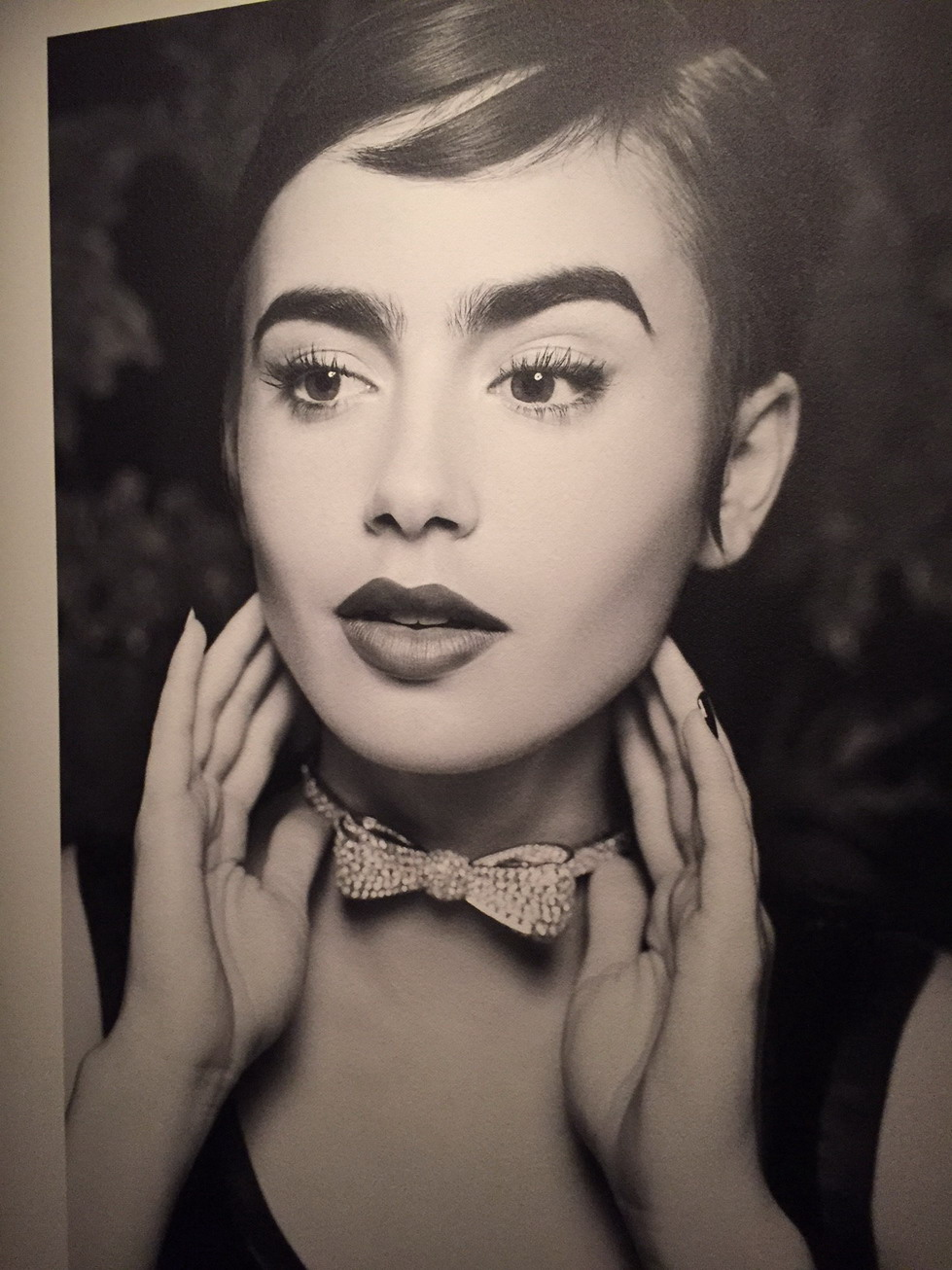 Lily Collins Chanel diamond bow necklace Saatchi exhibtion Oct 2015