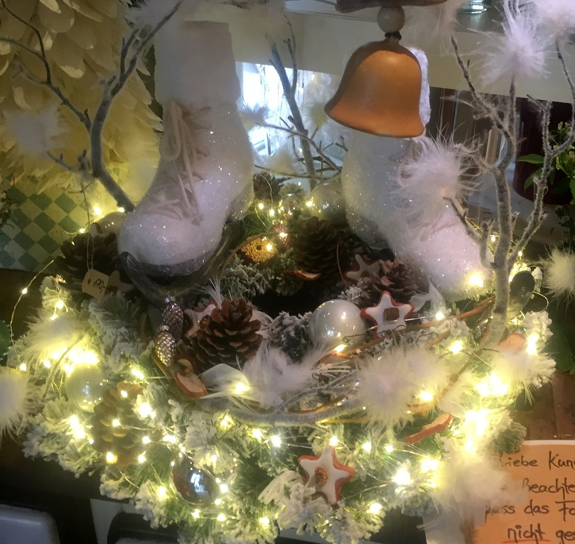 lighted advent wreath with white ice skaters
