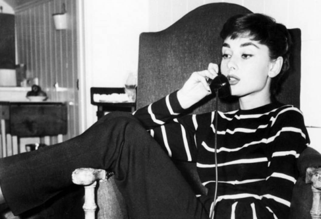 Audrey Hepburn looking chic in the nautical look.