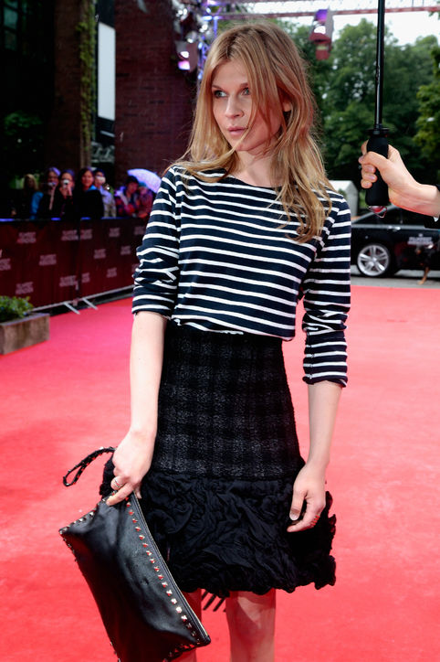 Love how Clemence Poesy mixes up styles: A relaxed sailor tee paired with a boucle tweed skirt. Parfait!