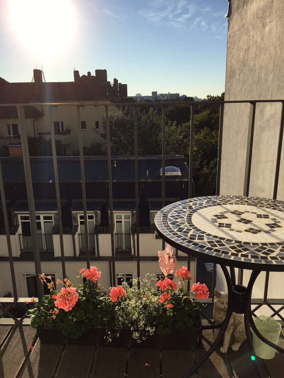"Balcony with Italian mosaic table. Our gorgeous ""Altbau"" flat is located in Berlin's trendy Prenzlauer Berg."